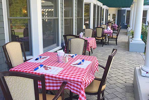 Photo of a food service-managed casual dining event on the patio of an assisted living community.