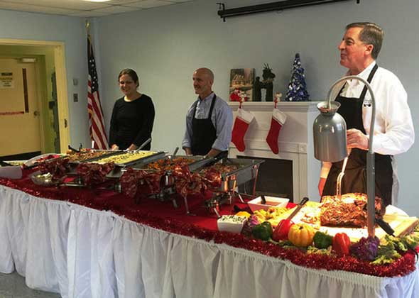 Photo of assisted living foodservice company serving a meal.