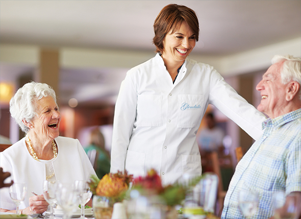 Photo of an assisted living food service employee with seniors