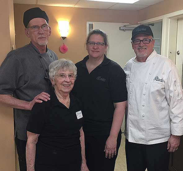 Photo of senior dining food service team.