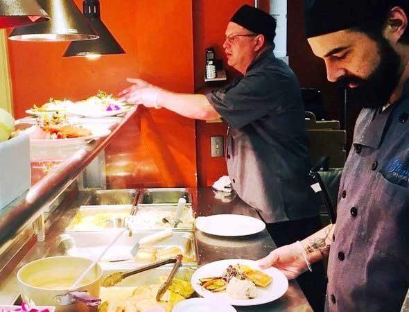 Photo of senior living food service team prepping meals.