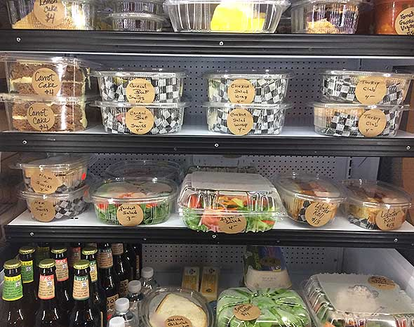 Photo of grab-n-go items in assisted living food service dining area.