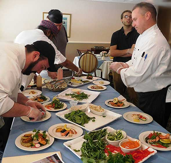 Photo of senior dining company crew preparing food service.