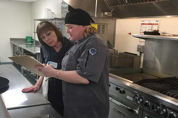 Photo of senior living food service chef and team member.